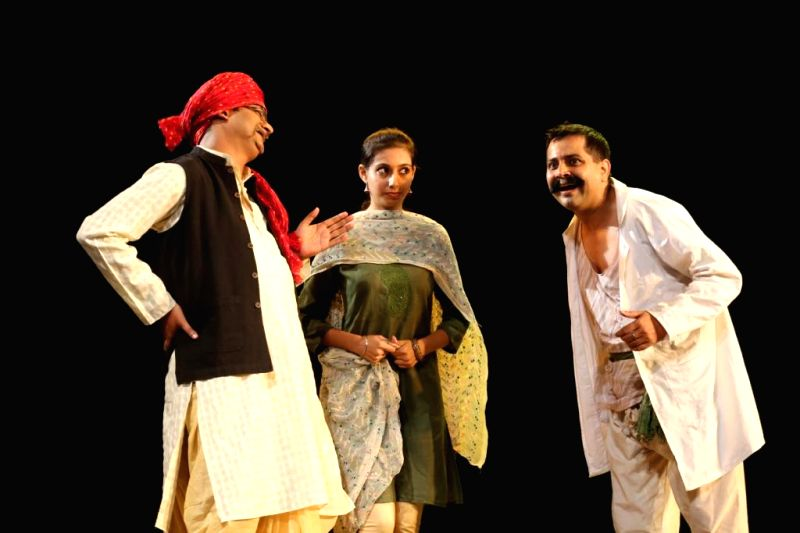 Artists stage `Neem Hakeem Khatra-e- Jaan` a play written by Moliere during the third annual theatre festival – `HridayManch` at Sri Ram Centre, Mandi House in New Delhi on Aug 29, 2014.