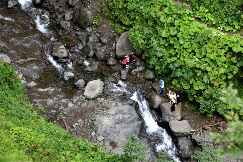 ARTVIN (TURKEY), Aug. 9, 2018 People have fun at the Maral Waterfall, a tourist attraction nearby Turkish-Georgian border, in Turkey's northeastern province of Artvin, on Aug. 5, 2018. ... - Mehmet Ersoy