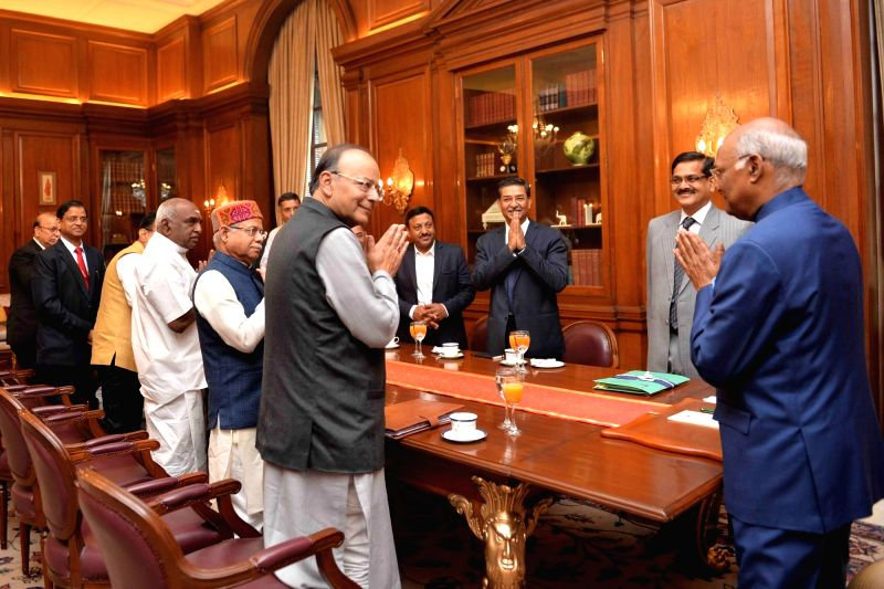 Arun Jaitley, Union Minister of Finance meeting President Ram Nath Kovind at Rashtrapati Bhavan before presenting the Budget 2018-19 in Parliament on Feb. 1, 2018. Also seen Pratap Shukla, ... - Arun Jaitley and Nath Kovind