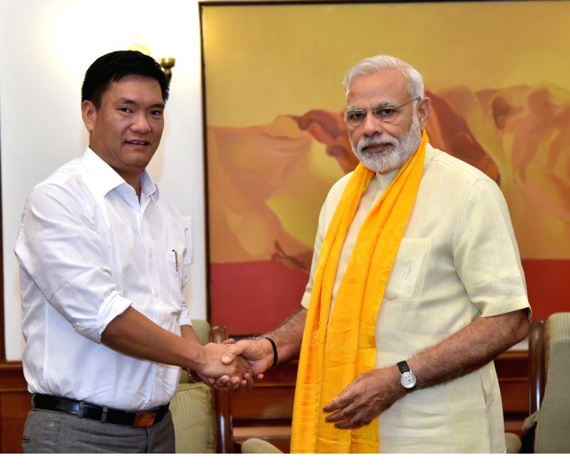 Arunachal Pradesh Chief Minister Pema Khandu calls on Prime Minister Narendra Modi, in New Delhi on July 24, 2016. - Pema Khandu and Narendra Modi