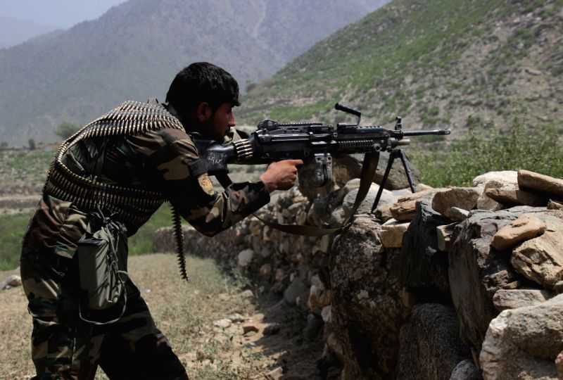 ASADABAD, Aug 5, 2018 - An Afghan security force member takes part in a military operation in Kunar province, eastern Afghanistan, Aug. 4, 2018. Scores of Taliban fighters have been killed over the ...