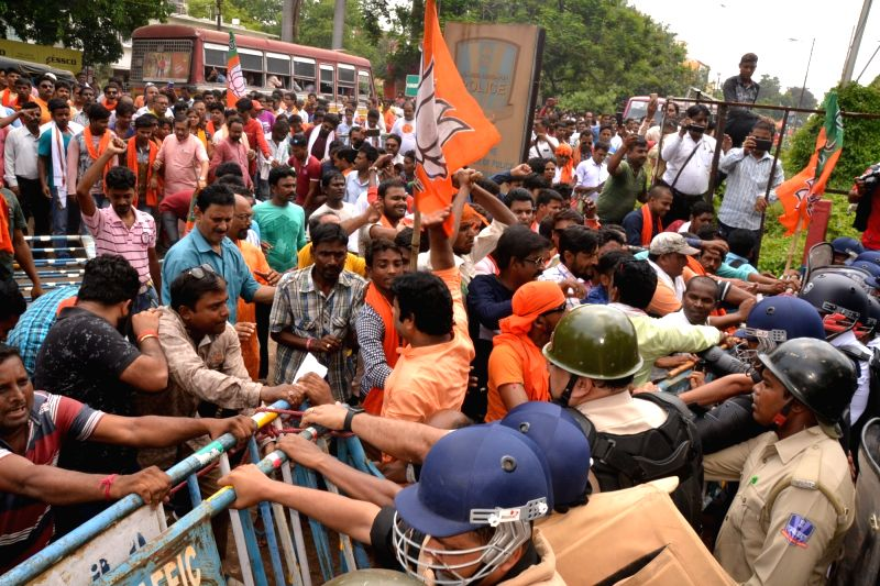 Asansol: BJP workers protesting against the ongoing political violence in West Bengal, 'gherao' Asansol Durgapur Police Commissionerate, in West Bengal's Asansol on June 24, 2019. (Photo: Indrajit Roy/IANS)