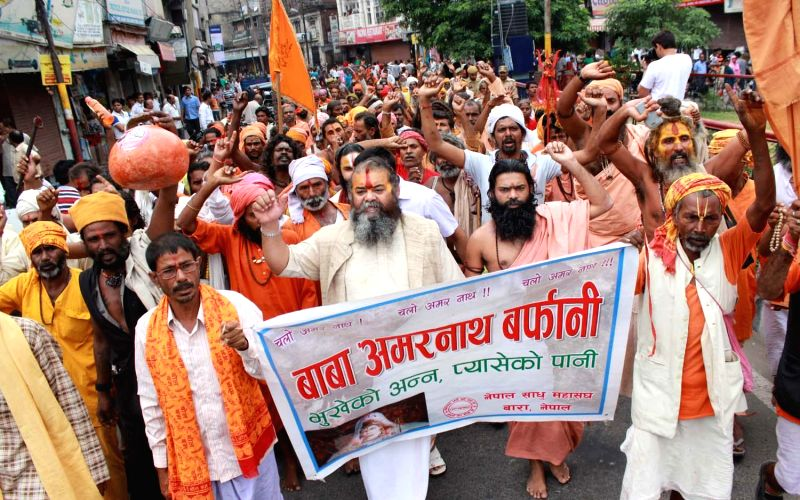 Ascetics stage a demonstration in Jammu to vent out their anger against torching of langar tents set-up for devotees at Baltal in Jammu and Kashmir, on July 19, 2014.