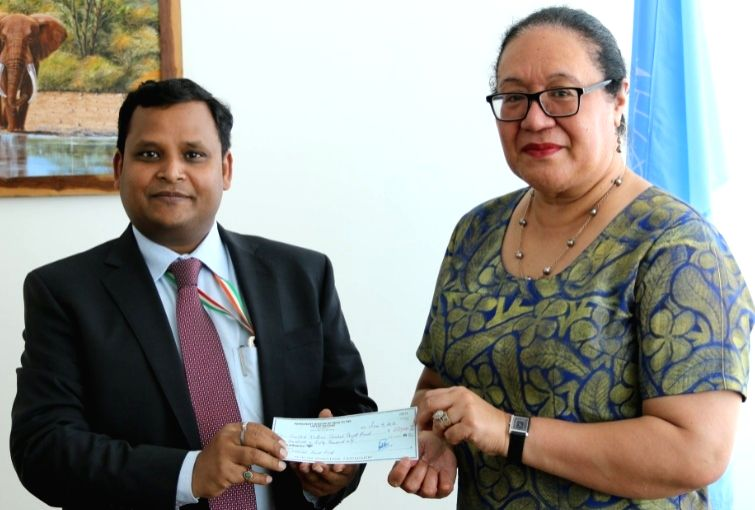 Ashish Sinha, a Counsellor at India's UN Mission hands over the cheque for $250,000 from India to United Nations Under Secretary-General Fekitamoeloa Katoa 'Utoikamanu on Thursday, June 7, 2018. ... - Ashish Sinha