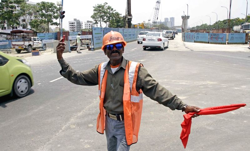 Ashok Dutta, Metro Railway Volunteer dances as he manages traffic at New Town in Kolkata on June 3, 2017.