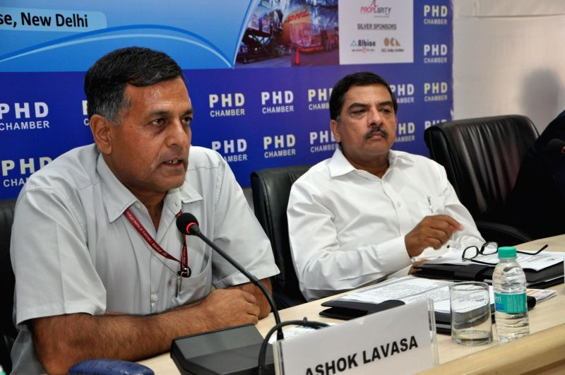 Ashok Lavasa, Secretary, Ministry of Civil Aviation addresses a round table conference on `Indian Air Cargo: Future Outlook` organised by PHD Chamber in New Delhi on July 12, 2014.