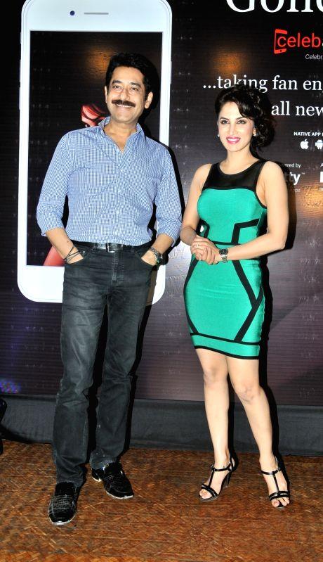 Ashok Shinde with Smita Gondkar during the launch of mobile application, Smita Gondkar app, in Mumbai, on July 22, 2016.