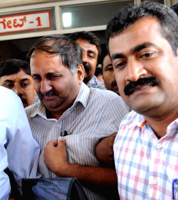 Ashwin Rao, son of Lokayukta Y Bhaskar Rao, being taken to be produced in a Bengaluru court on July 28, 2015. - Ashwin Rao