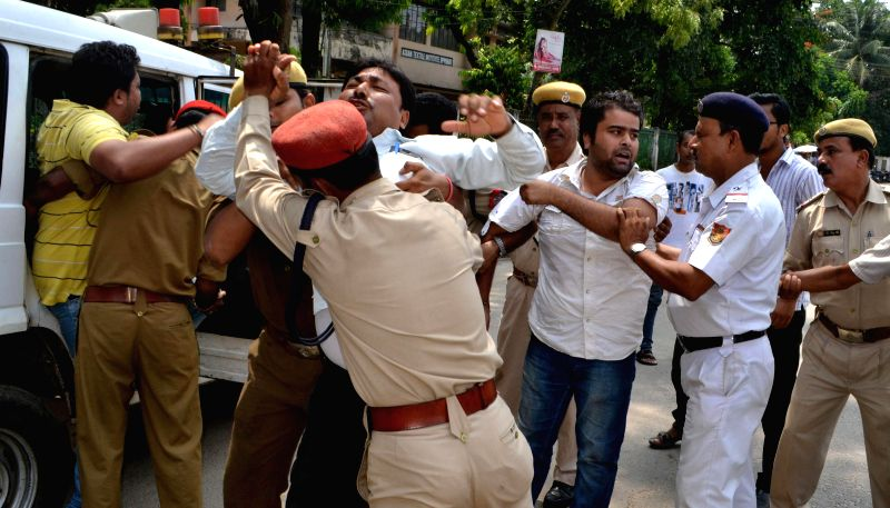 Asom Gana Parishad (AGP) activists demonstrate during a 12-hour Assam bandh, called to protest against recent violence in Golaghat of Assam, in Guwahati on Aug 21, 2014.