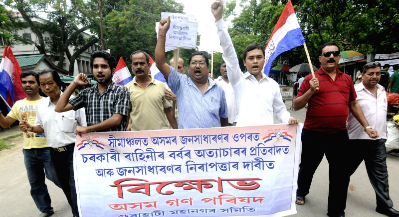 Asom Gana Parishad (AGP) activists take out a rally to condemn the recent violence in Golaghat of Assam, in Guwahati on Aug 22, 2014.