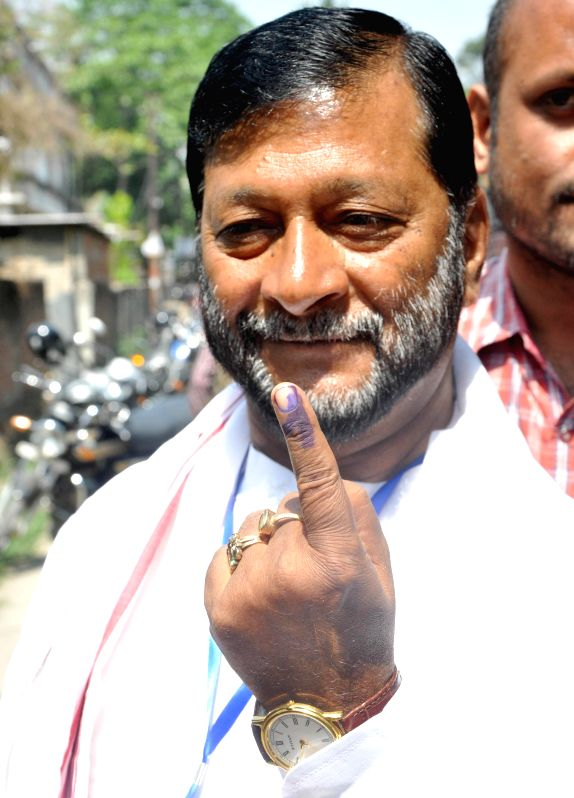 Asom Gana Parishad (AGP) candidate for 2014 Lok Sabha Election from Guwahati Lok Sabha seat Birendra Prasad Baishya shows his fore finger marked with phosphorous ink after casting his vote at a ...