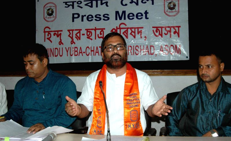 Asom Hindu Yuba Chattra Parishad chief Brajen Kakoty addresses a press conference in Guwahati on June 24, 2014.