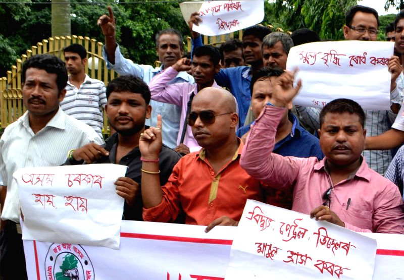 Asom Jatiyatabadi Yuba Chatra Parishad (AJYCP) activists stage a demonstration to protest against hike in prices of essential commodities in Bangalore on July 2, 2014.