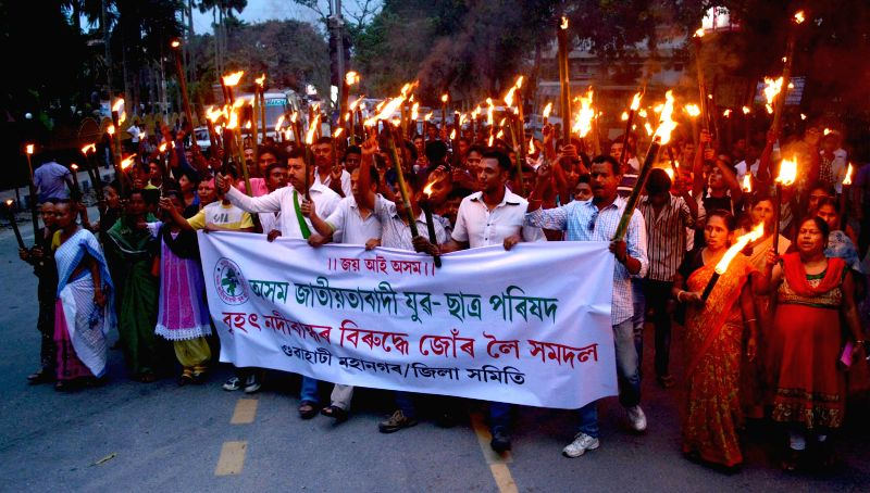 Asom Jatiyatabadi Yuba Chatra Parishad (AJYCP) activists participate in a torch rally organised to protest against revival of Lower Subansiri Hydro-Electric Power project by the central government in