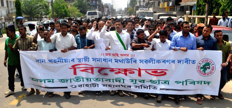 Asom Jatiyatabadi Yuva Chatra Parishad (AJYCP) activists during a protest rally in Guwahati on May 13, 2014.