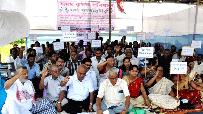 Asom Krishak Parishad activists stage a demonstration in Guwahati on Aug 28, 2014.