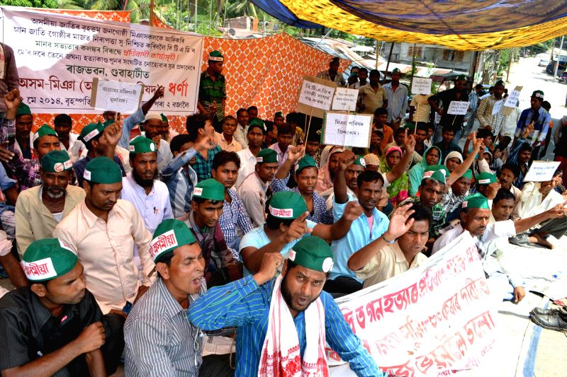 Asom Miya (Asomiya) Parishad (AMP) activists demonstrate against recent BTAD violence near Raj Bhawan in Guwahati on May 15, 2014.