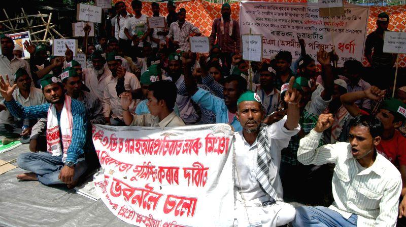 Asom Miya (Asomiya) Parishad (AMP) activists demonstrate against recent BTAD violence near Raj Bhawan in Guwahati on May 15, 2014.