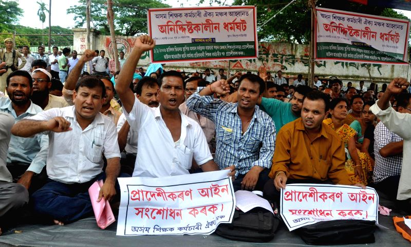 Asom Sikshak Karmachari Oikyo Mancha (ASKOM) members sit in indefinite strike demanding provincialisation of public sector high schools and colleges , Madrassa and Sankrit tol set up from 2006 in ...