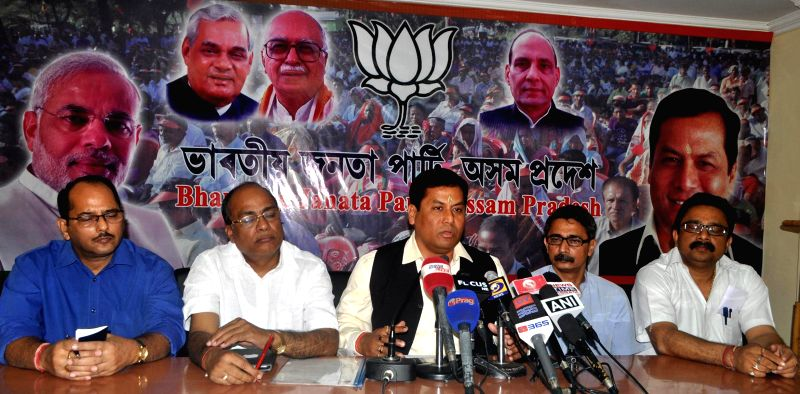 Assam BJP chief Sarbananda Sonowal addresses a press conference in Guwahati on April 11, 2014.