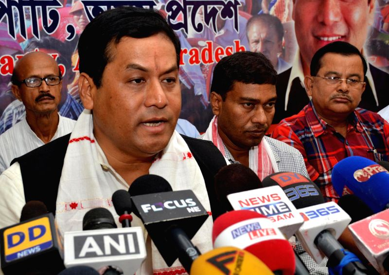 Assam BJP chief Sarbananda Sonowal addresses a press conference in Guwahati on May 17, 2014.