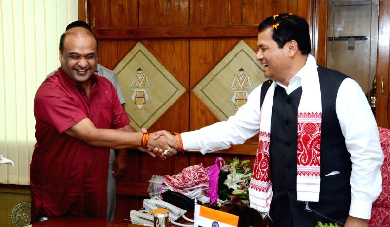 Assam Chief Minister Sarbananda Sonowal being greeted by Himanta Biswa Sarma at Assam Secretariat in Guwahati, on June 2, 2016. - Sarbananda Sonowal