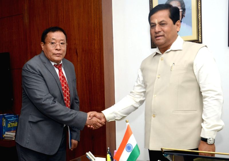 Assam Chief Minister Sarbananda Sonowal during a meeting with Bhutan Chamber of Commerce and Industry (BCCI) Secretary General Phub Tshering at his residence, in Guwahati on June 7, 2018. - Sarbananda Sonowal