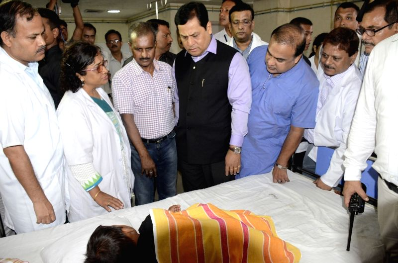 Assam Chief Minister Sarbananda Sonowal visits Guwahati Medical College and Hospital to take stock of the health condition of those injured in Kokrajhar violence in Guwahati on Aug 6, 2016. - Sarbananda Sonowal