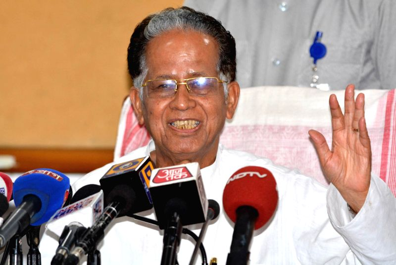 Assam Chief Minister Tarun Gogoi addresses a press conference conference in Guwahati on June 19, 2014.