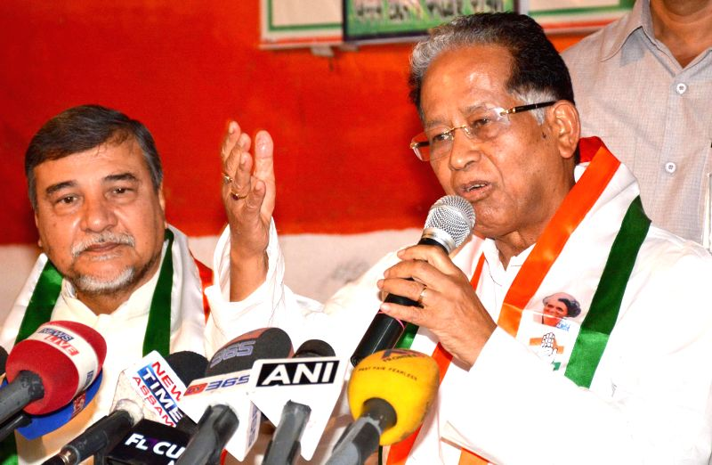 Assam Chief Minister Tarun Gogoi and Assam Congress chief Bhubaneswar Kalita address a press conference regarding the Third phase of 2014 Lok Sabha Polls in Assam, at Rajiv Bhawan in Guwahati on ...