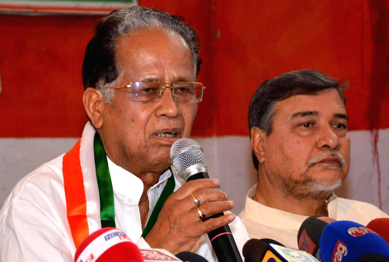 Assam Chief Minister Tarun Gogoi and Assam Congress chief Bhubaneswar Kalita during a press conference in Guwahati on May 17, 2014.