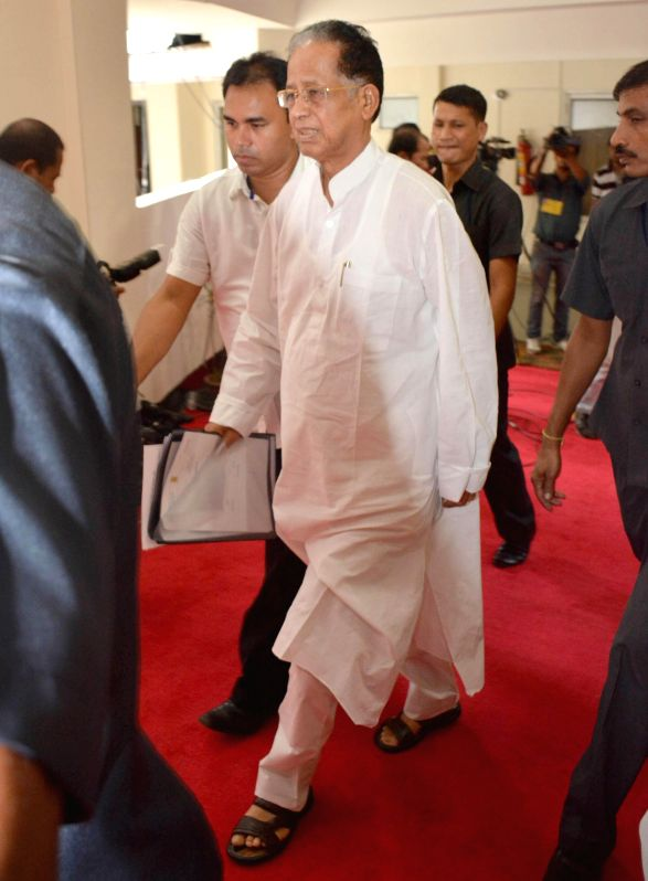 Assam Chief Minister Tarun Gogoi arrives to attend the last day of the budget session at Assam Legislative Assembly (ALA) in Guwahati on Aug. 30, 2014.