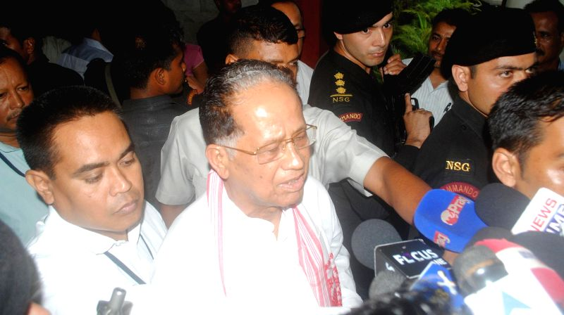 Assam Chief Minister Tarun Gogoi arrives to meet Leader of the Congress parliamentary party in Lok Sabha Mallikarjun Kharge in Guwahati on June 24, 2014.