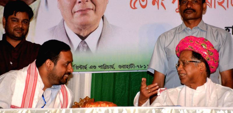 Assam Chief Minister Tarun Gogoi campaigns for party's Lok Sabha candidate from Guwahati, Manash Bora during an election campaign in Guwahati on April 11, 2014.
