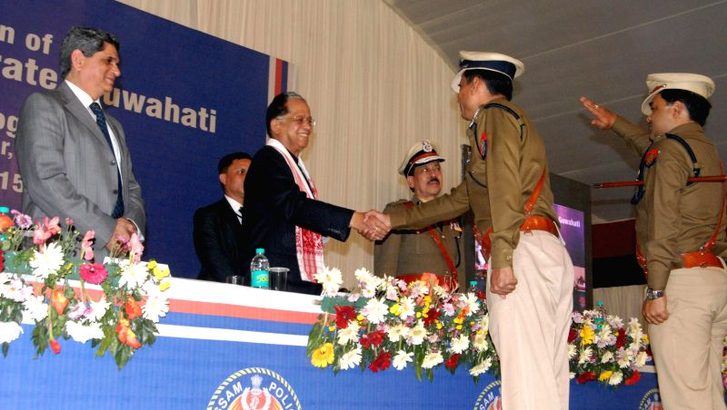 Assam Chief Minister Tarun Gogoi congratulates ADGP Jyotirmoy Chakraborty, the first Police Commissioner for Guwahati (Metro) during a programme in Guwahati, on Jan 1, 2015. - Tarun Gogoi and Jyotirmoy Chakraborty