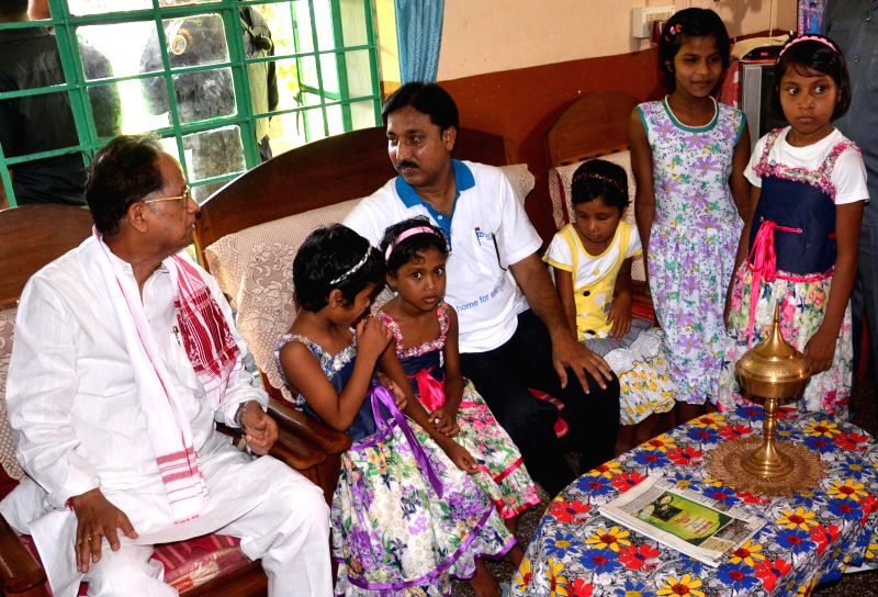 Assam Chief Minister Tarun Gogoi during his visit to SOS children's village at Azara in Guwahati on July 9, 2014.
