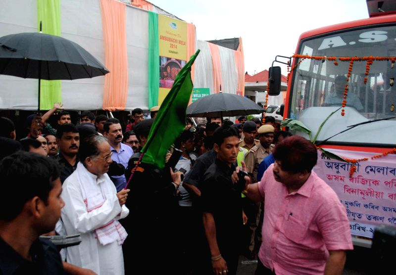 Assam Chief Minister Tarun Gogoi flagging off the Bus service to Kamakhya Temple among the devotees coming from across the country during the inauguration of the Ambubachi Mela, organized by Assam ...