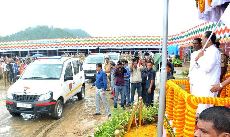 Assam Chief Minister Tarun Gogoi flags-off Police assistance vehicle during 68th Independence Day celebrations at Veterinary Field in Guwahati on Aug 15, 2014.