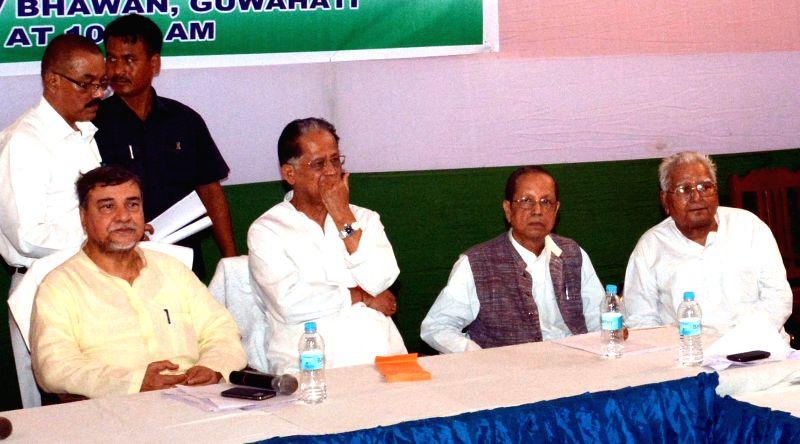 Assam Chief Minister Tarun Gogoi with Assam Congress President Bhubneshwar Kalita and others during Assam Congress Executive meeting at Rajiv Bhawan in Guwahati on July 3, 2014. - Tarun Gogoi