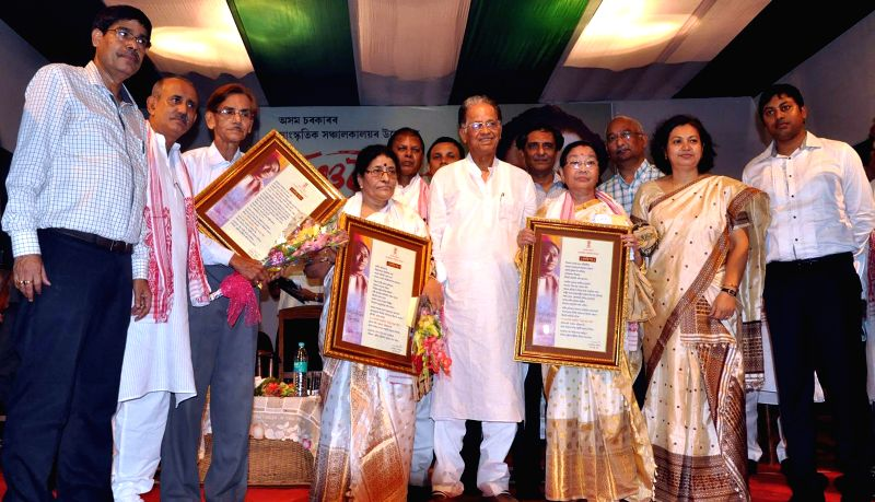 Assam Chief Minister Tarun Gogoi with Bishnu Rabha Award winners for the year 2014 during a programme organised on Bishnu Rabha Divas at District Library Auditorium in Tezpur of Assam on June 20, ... - Tarun Gogoi