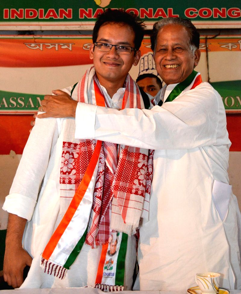 Assam Chief Minister Tarun Gogoi with his son Gourav Gogoi who won Kaliabor parliamentary seat of Assam, in Guwahati on May 17, 2014.