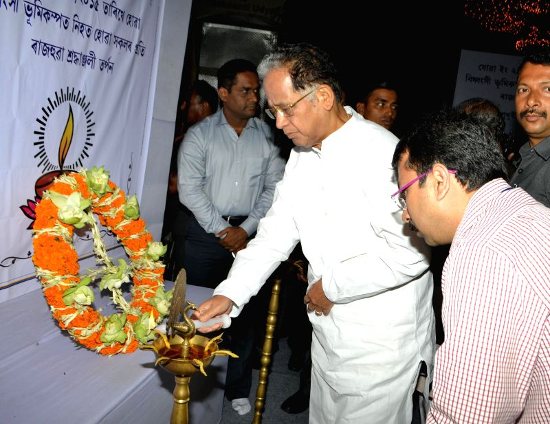 Assam Chief Minster Tarun Gogoi pays tribute to the victims of Nepal earthquake in Guwahati, on April 30, 2015.