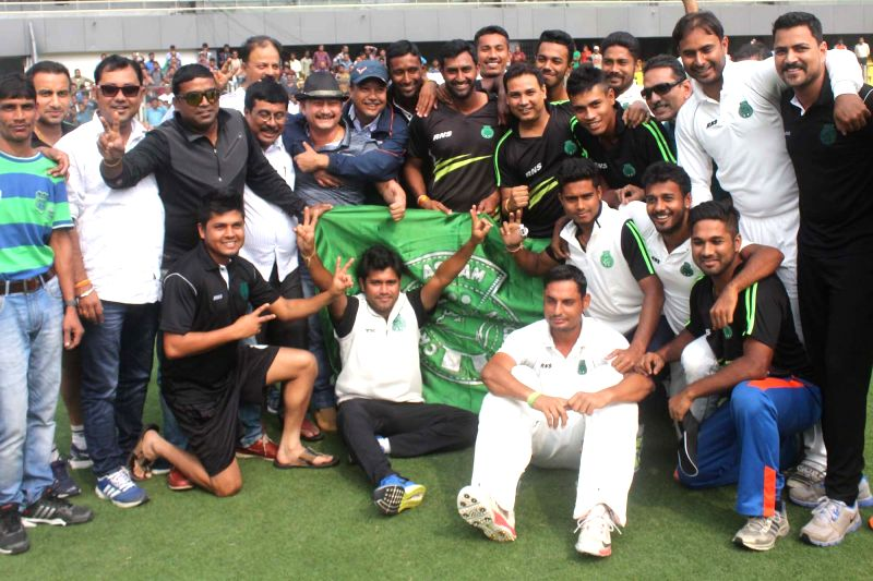 Assam cricket team celebrate their win against Delhi during a Ranji Trophy match at Barshapara stadium in Guwahati, on Nov 18, 2015.