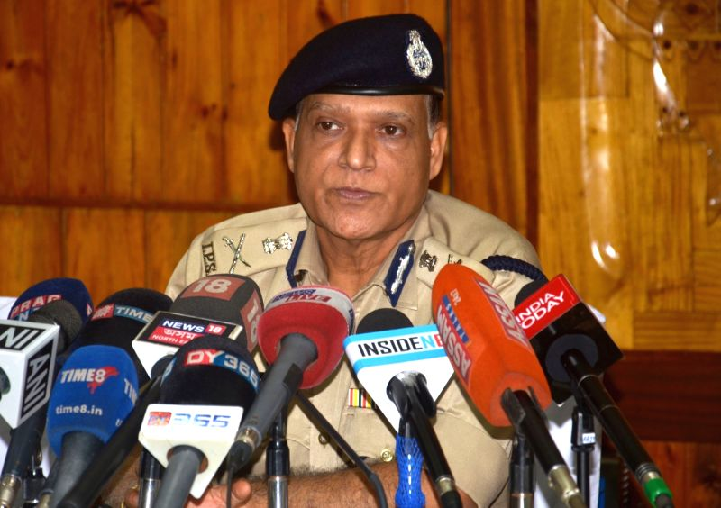 Assam Director General of Police Kuladhar Saikia addresses a press conference at Assam Police Headquarters,in Guwahati, on July 13, 2018.