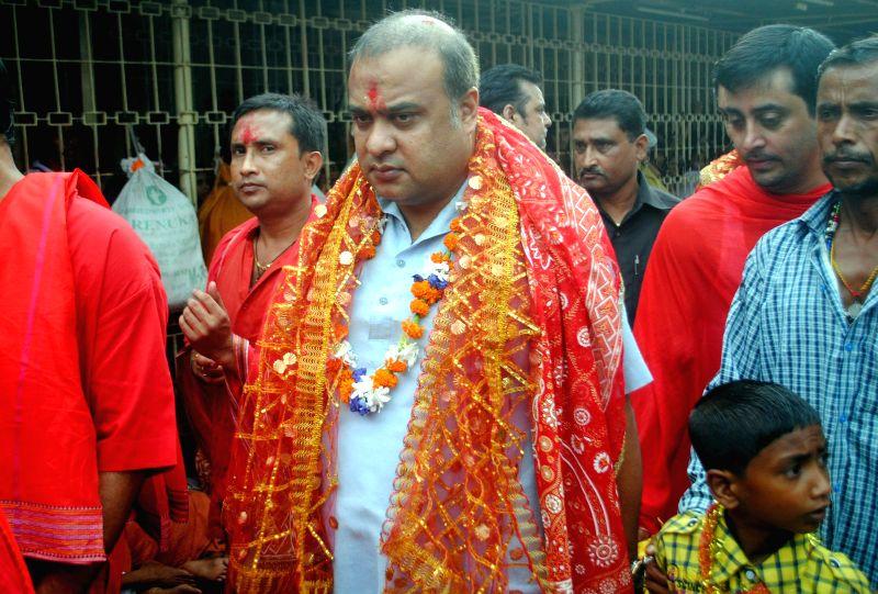 Assam Education and Health Minister Himanta Biswa Sarma arrives at the Kamakhya during Ambubachi Mela, also known as Ambubasi festival in Guwahati on June 26, 2014.