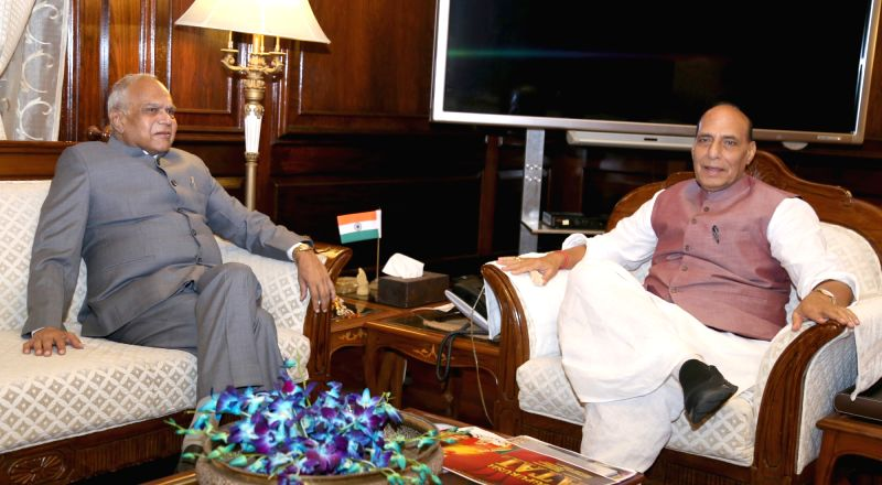 Assam Governor Banwarilal Purohit calls on the Union Home Minister Rajnath Singh in New Delhi on Aug 11, 2017. - Rajnath Singh