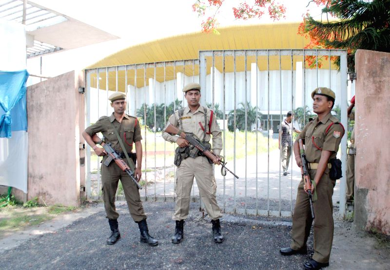 Assam police personnel deployed at Rajiv Gandhi indoor stadium where counting centre for 2014 Lok Sabha polls has been setup in Guwahati on May 15, 2014.