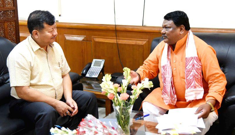 Assam Welfare of Plain Tribes Minister Chandan Brahma meets Union Tribal Affairs Minister Jual Oram, in New Delhi, on Aug 7, 2018. - Chandan Brahma