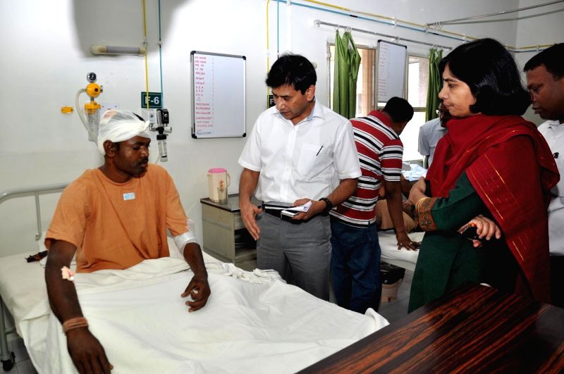 Assistant Chief Electoral Officer K K Sone meets a jawan injured in Dumka Maoist attack, at a hospital in Ranchi on April 25, 2014. At least 8 policemen were killed and thirteen others injured in a ..