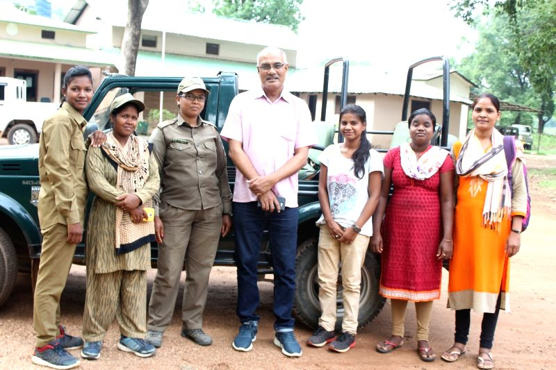 Assistant Director of the Kanha National Park S.K Khare with his team.
